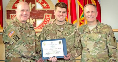 Pte Aaron Eastman, centre, of Sennelager-based 1 Armd Med Regt receives the coveted Expert Field Medical Badge award from US Army Europe's Col Brian Almquist, Commander 212 Combat Support Hospital, left, and Gen Phillip Jolly, Deputy Commanding General, Mobilization & Reserve Affairs Director