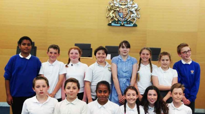 Year Six pupils from Bielefeld School smiling after holding a successful mock trial