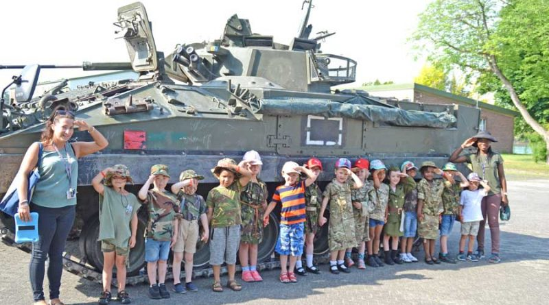 Children from Bishopspark School saluting in their best camouflage outfits